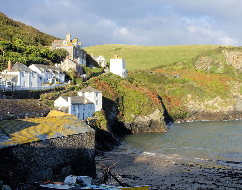 Picturesque harbourside views from Quay Cottage, a holiday house in Port Isaac, with whitewashed old cottages on the cliffside.