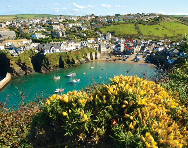 Aerial photograph of picturesque Port Isaac and the location of The Mizzen, a self catering holiday cottage on the rugged North Cornish Coast.