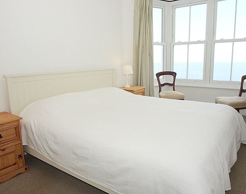 Super king size bedroom with sea views in Bellevue, a self catering, seaside holiday house to rent in Port Isaac, Cornwall.