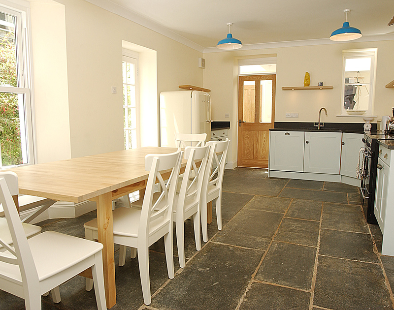 Contemporary kitchen with original slate flooring at Bellevue, a self catering family holiday house to rent by the sea in Port Gaverne, Port Isaac, Cornwall.