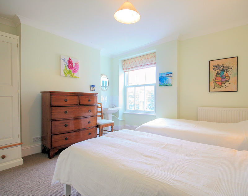 Pretty light-filled twin bedroom in Bellevue, a self catering holiday house by the sea in Port Isaac, North Cornwall.