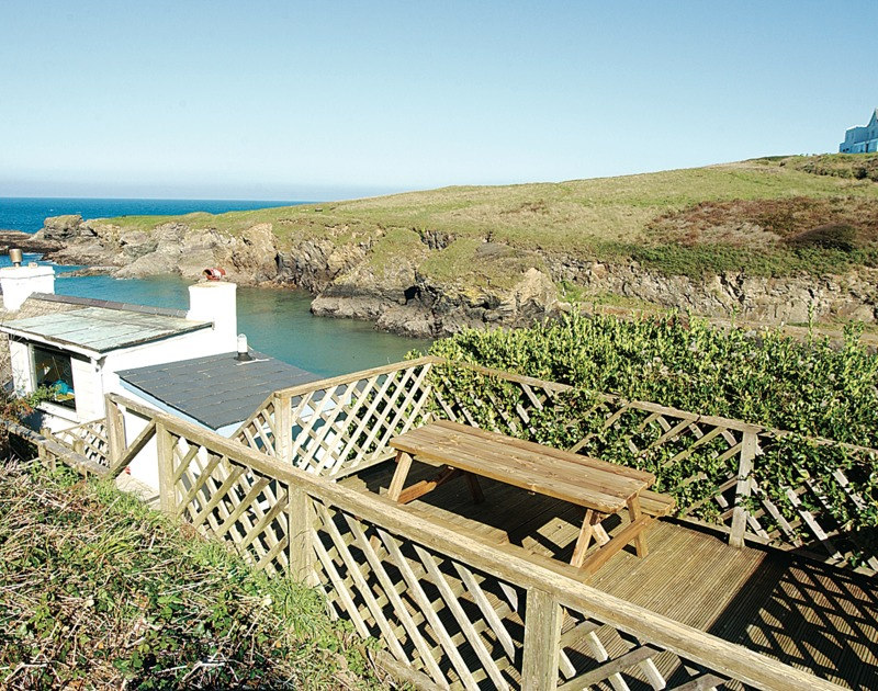 The enclosed, elevated patio of Rockies, a splendid holiday house in Port Isaac, Cornwall, with views over Port Gaverne.