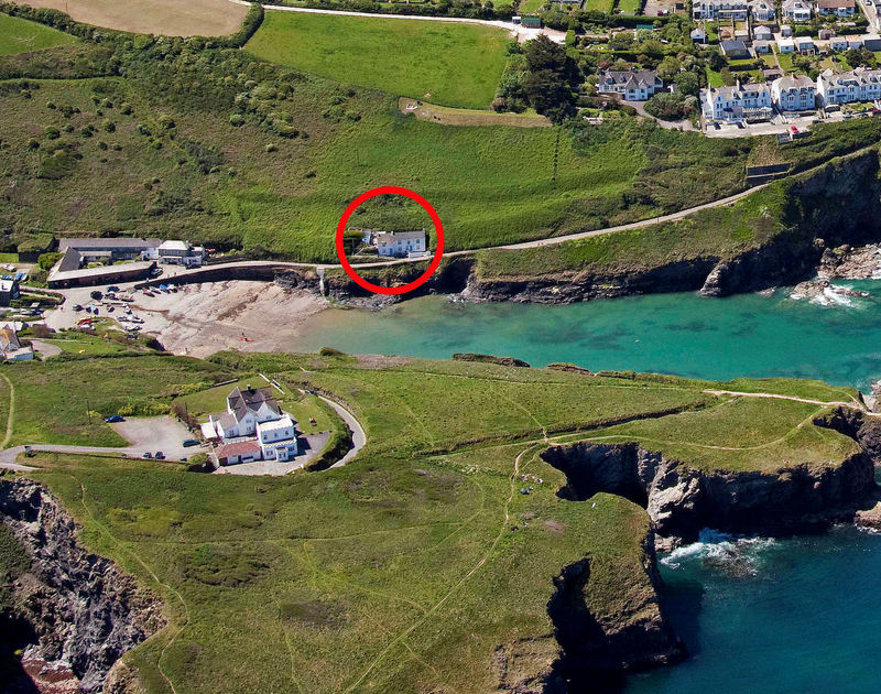 A red circle indicating the cliffside location of Rockies, a holiday house near Port Isaac, Cornwall, with Port Gaverne cove in the foreground.