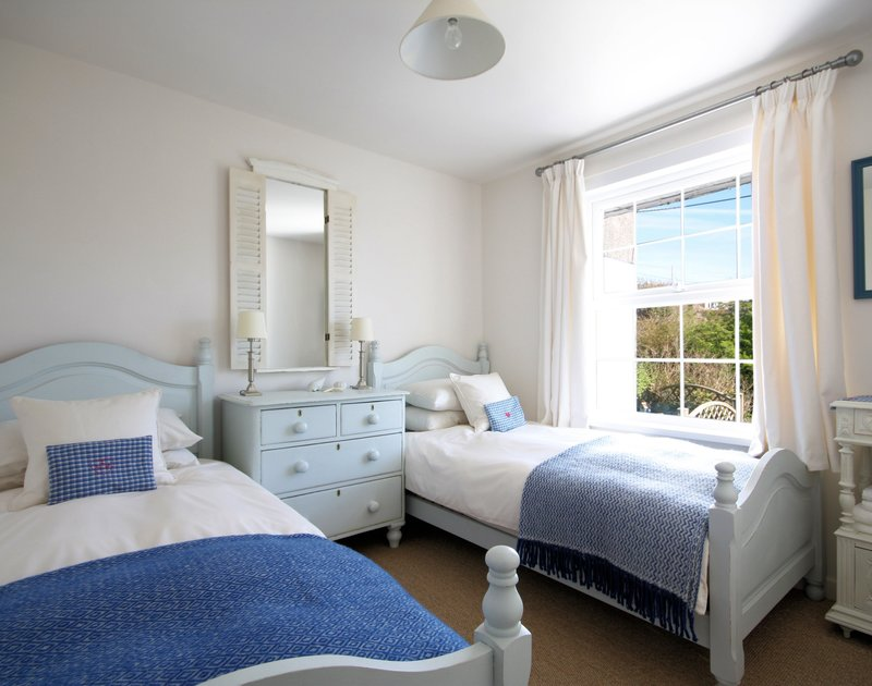 Delightful twin bedroom in Castaway, a luxurious and beautifully decorated and furnished self catering seaside, holiday rental in Port Isaac, Cornwall.
