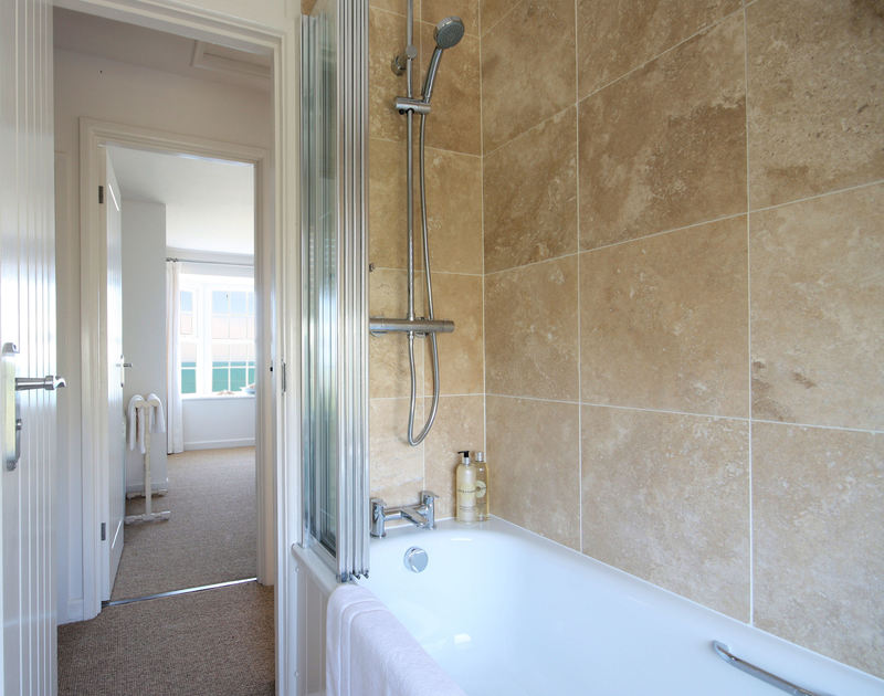 An immaculate and contemporary bathroom in Castaway, a self catering,luxurious holiday rental with sea views at Port Isaac, Cornwall.