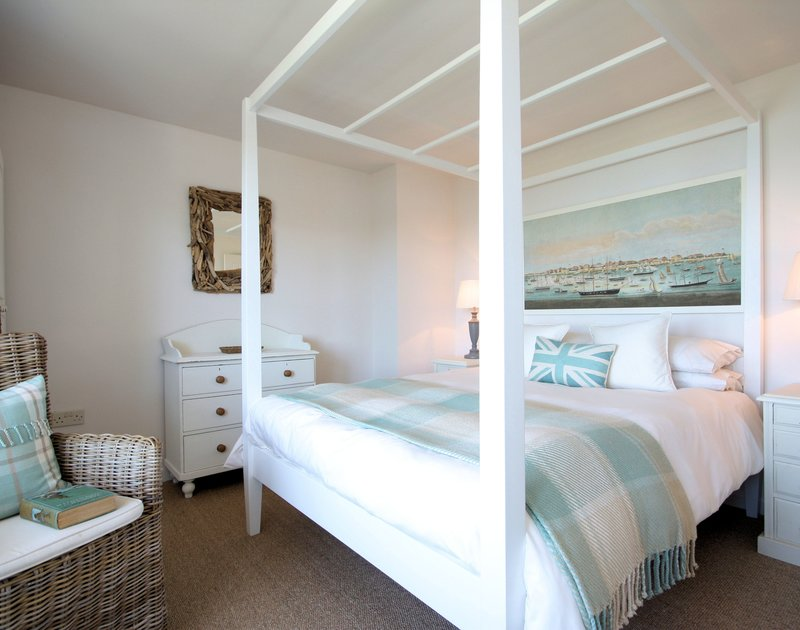 Luxurious four poster bed in the beautifully decorated and furnished master bedroom in Castaway, a romantic holiday retreat or a small family retreat of up to four people in Port Isaac, Cornwall.