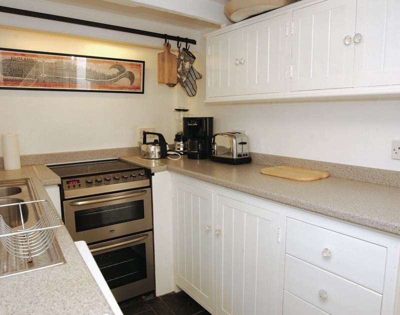 Fitted kitchen in The Cobweb, a self catering holiday cottage in the heart of Port Isaac in North Cornwall.