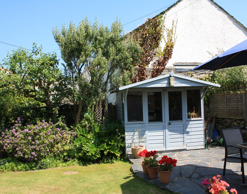 The shed and patio of Brook Cottage, a self-catering holiday cottage in Port Isaac, Cornwall