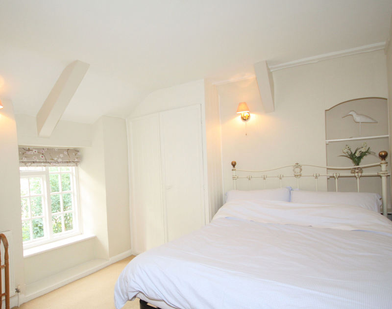 One of three double bedrooms at Brook Cottage, a holiday house in Port Isaac, Cornwall, with built in wardrobe.