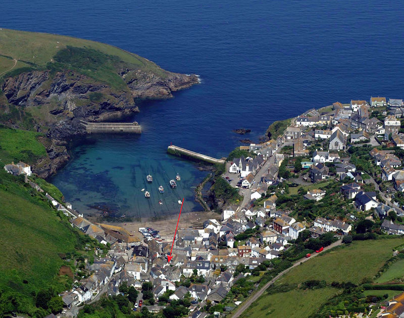 Aerial view of picturesque Port Isaac on the rugged North Coast of Cornwall with self catering holiday cottage St Samson shown in red.