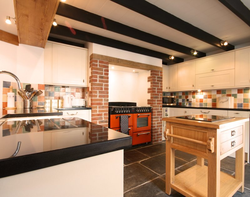Smart, modern kitchen at Morwenna, a self-catering holiday house in Port Isaac, Cornwall, with large range cooker.