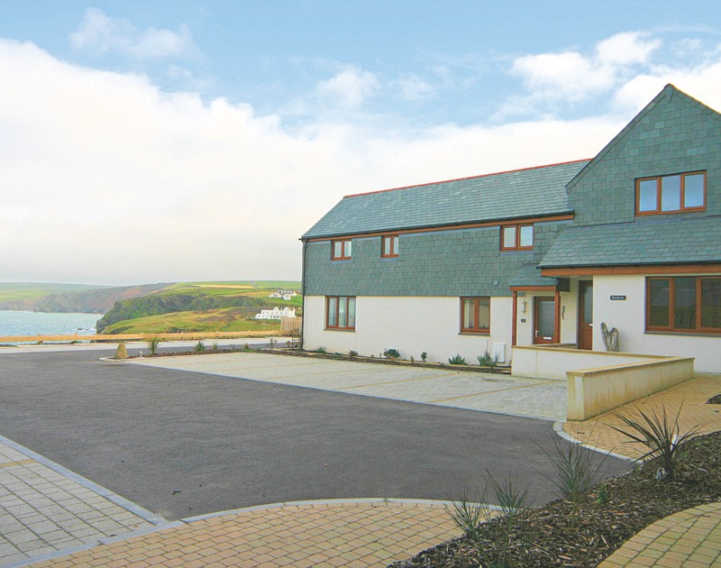 The exterior of Seaspray, a self-catering holiday house in Port Isaac, Cornwall, with sea views.