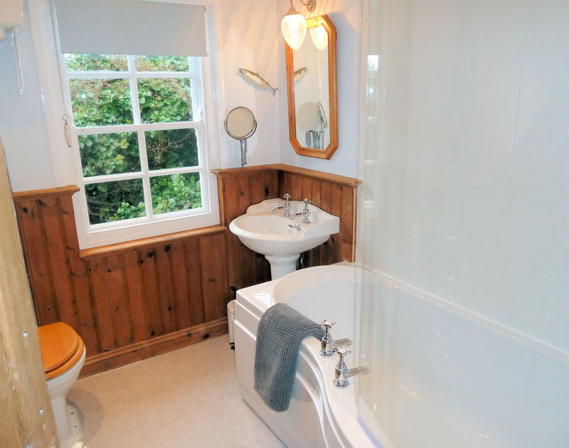 The bathroom in Mermaid Cottage a quaint and charming self catering holiday rental in Port Isaac, Cornwall.