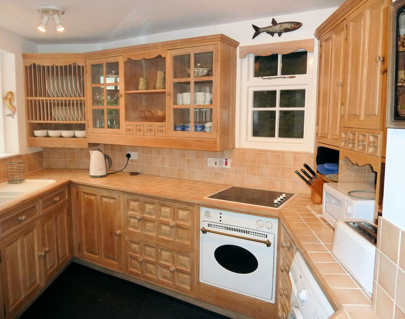 The kitchen in Mermaid Cottage, a self catering holiday rental in Port Isaac, North Cornwall.