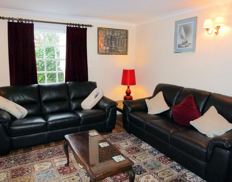 The cosy sitting room in Mermaid Cottage, a self catering holiday cottage to rent in Port Isaac, Cornwall.