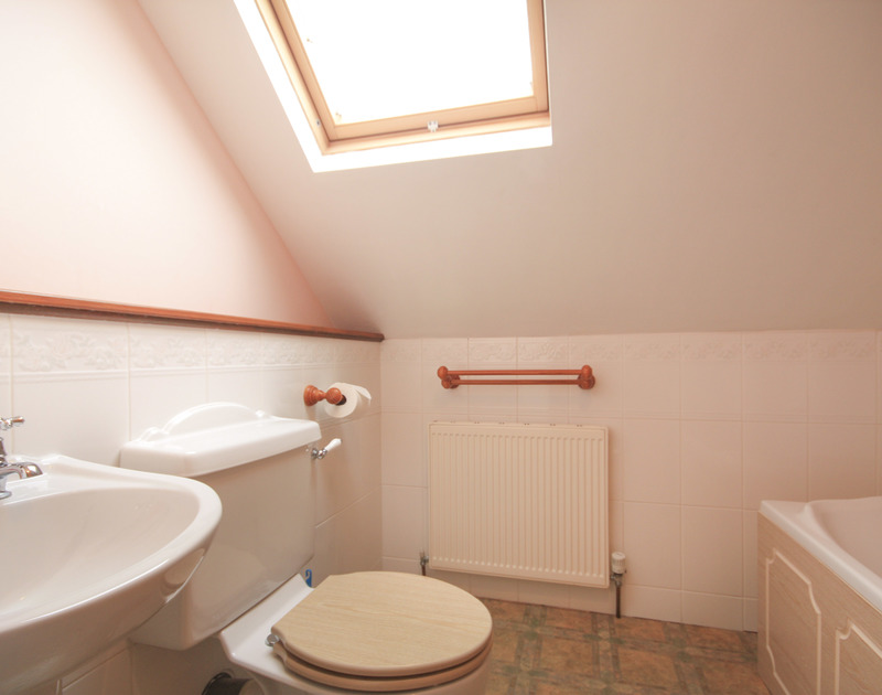 The well-lit bathroom of Haven Cottage, a holiday rental in Port Isaac, Cornwall, with velux window.