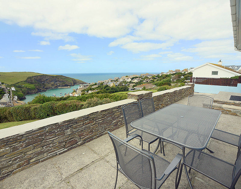 Beautiful habour and sea views from the patio of Pebblestones, a holiday house with weather proof furniture in Port Isaac, Cornwall.