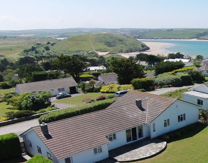 An aerial view of the back of Trebartha looking towards Brea Hill and Daymer Bay and the mouth of the Camel Estuary towards Padstow, a self catering family holiday house by the sea in Daymer Bay, Cornwall.