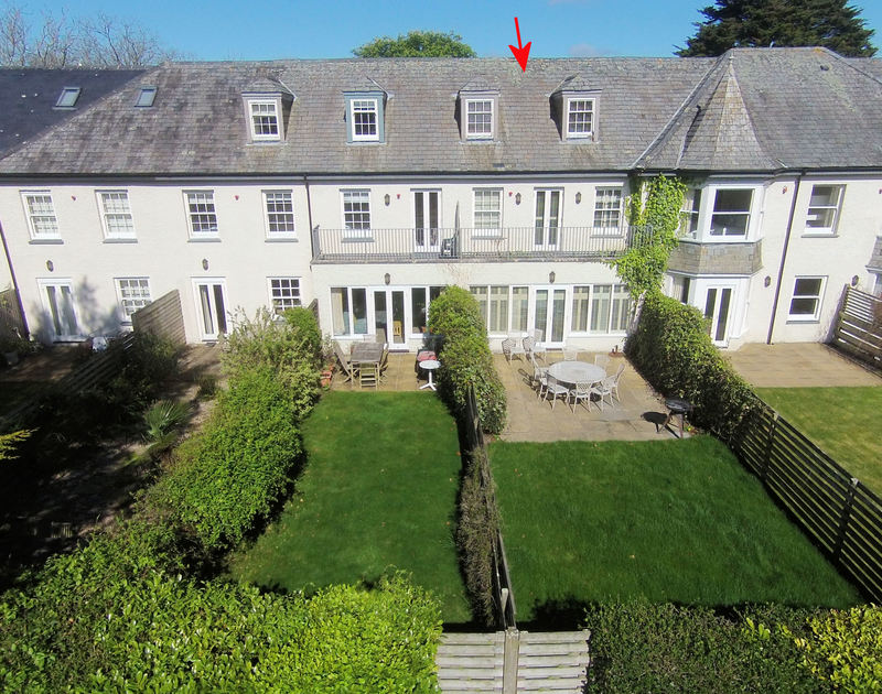 An aerial view of the exterior and lawned garden of Lowenna Manor 5, a holiday house in Rock, Cornwall
