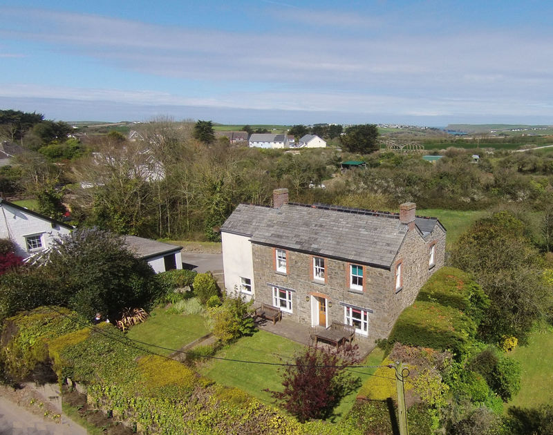 An aerial view of Conifers, an attractive stone holiday house with a large garden in Rock, North Cornwall.