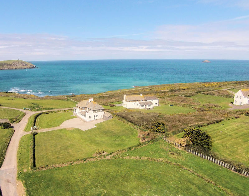 An aerial view of the beautiful coastal location of Spindrift, a holiday house near Daymer Bay, Cornwall, with its large lawned grounds.