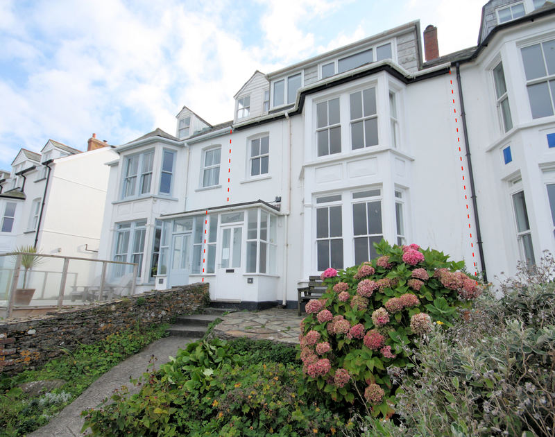 Front of house shot with red lines showing terraced self catering holiday house Seaward in Port Isaac, Cornwall.