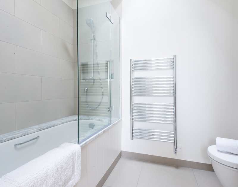 Sleek, ensuite bathroom at Tregye, a luxury holiday house in Rock, Cornwall with bath and overhead shower.