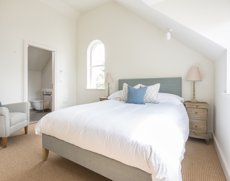 Kingsize double bedroom at Tregye, a luxury holiday house in Rock, Cornwall, with ensuite bathroom and vaulted ceiling.