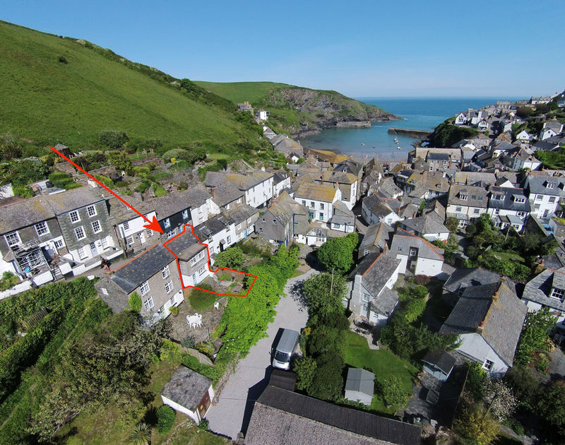 An aerial view of self catering, holiday cottage The Fo'c'sle; and its perfect location in the heart of Port Isaac's pretty harbour village in North Cornwall.