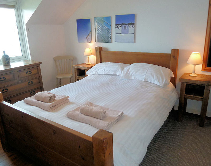 The double bedroom, with king size bed and sea views at 3 Overcliff, a holiday house in Port Isaac, Cornwall.