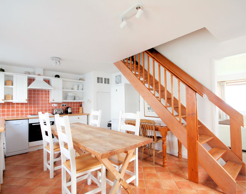 Light-filled kitchen with attractive terracotta floor tiles at 3 Overcliff, a self-catering holiday cottage in Port Isaac, Cornwall