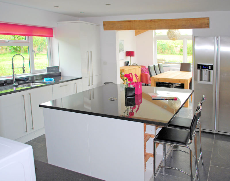 Glossy kitchen of The Terrace, a self-catering holiday house in Port Isaac, Cornwall with american style fridge/freezer.