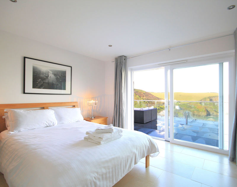 Gorgeous views from the master double bedroom of The Terrace, a holiday house in Port Isaac, Cornwall, with doors to the terrace.