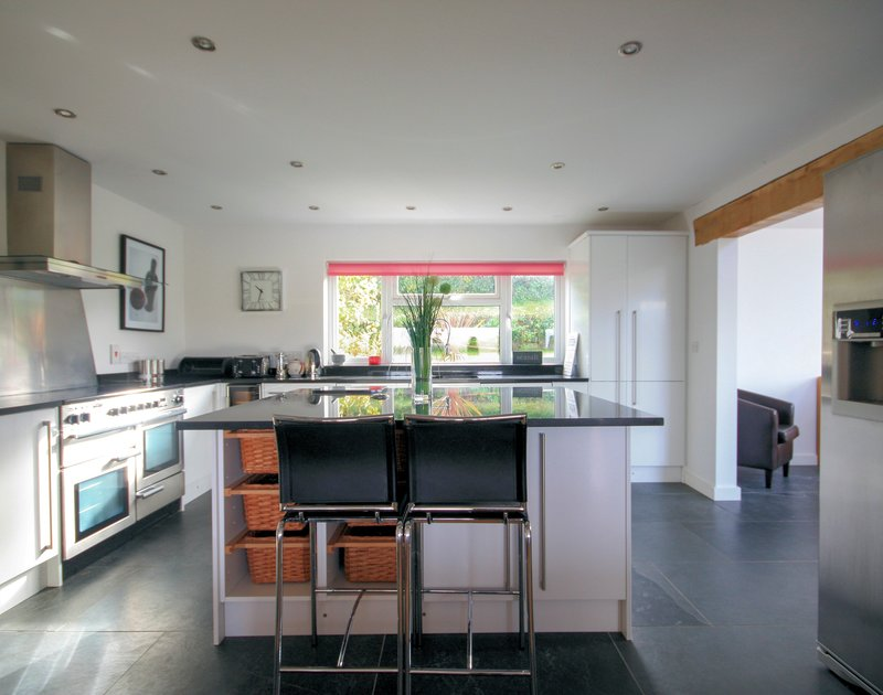 Contemporary kitchen with large central island at The Terrace, a superb holiday house in Port Isaac, Cornwall