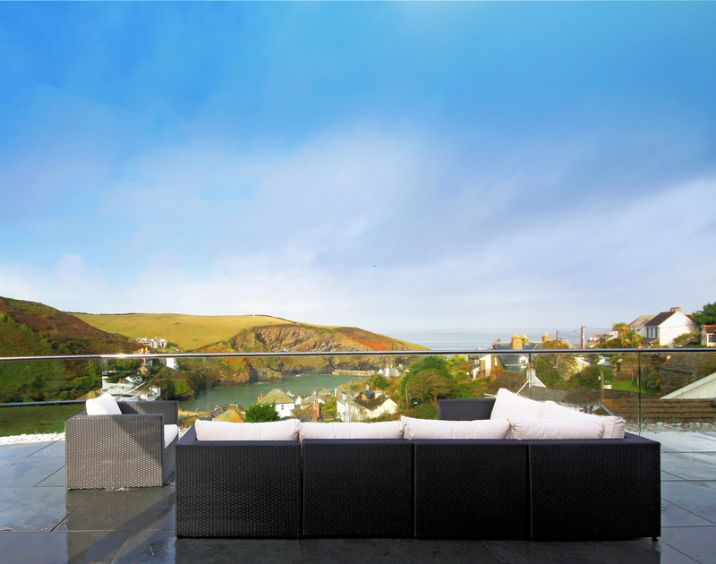 Breathtaking seaviews from The Terrace, a luxury holiday house in Port Isaac, Cornwall, with 2 outdoor sofas.