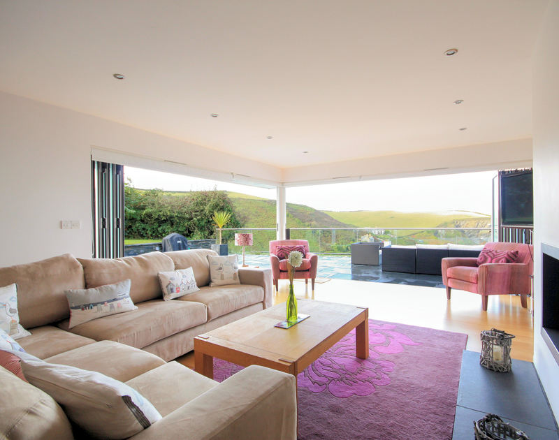 Throw open the bi-fold doors of the large sitting room at The Terrace, a holiday house in Port Isaac, Cornwall