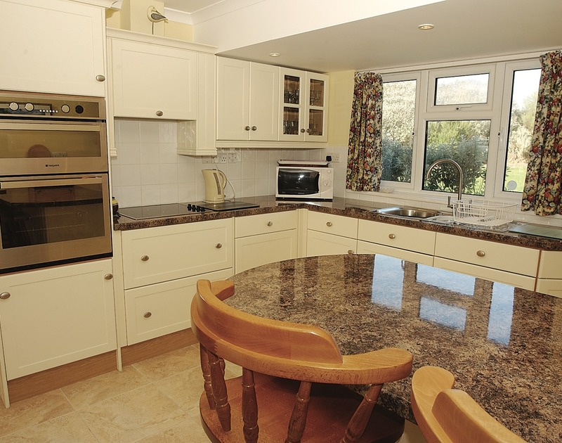 The attractive, modern kitchen of Higher Crawallis, self-catering holiday house near Daymer Bay, Cornwall