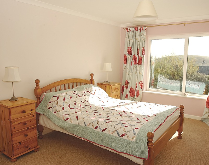 Double bedroom with view of Brea Hill at Tristan, a holiday house at Daymer Bay, Cornwall