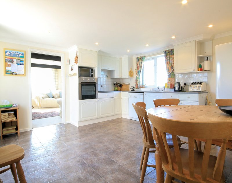 The spacious open plan kitchen/dining room in  Maylands, self catering holiday accommodation above Port Gaverne near Port Isaac in Cornwall.
