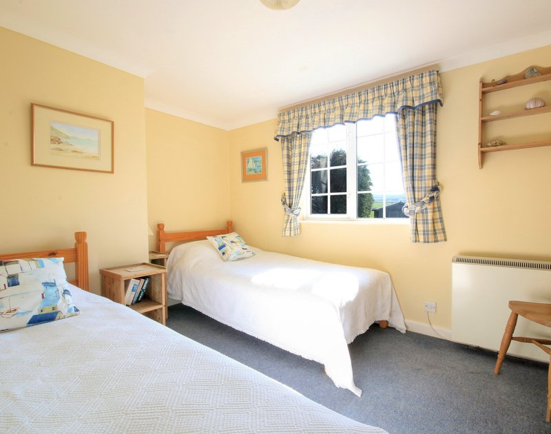 The twin bedroom in Maylands, a self catering holiday property to rent above Port Gaverne in North Cornwall.