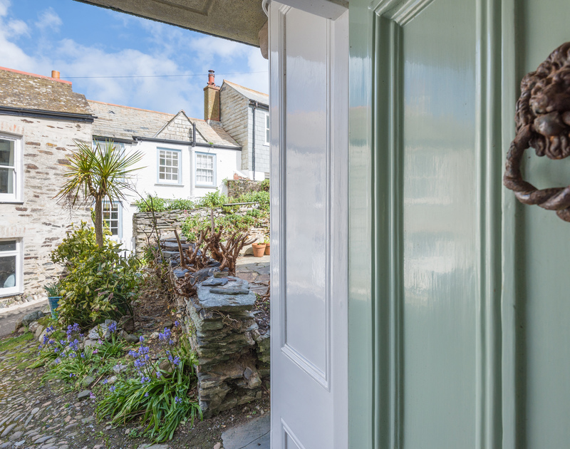 Front door leading to the cobbled path to the front of Dolphin Cottage in Port Isaac; leading to the feature narrow streets in the village