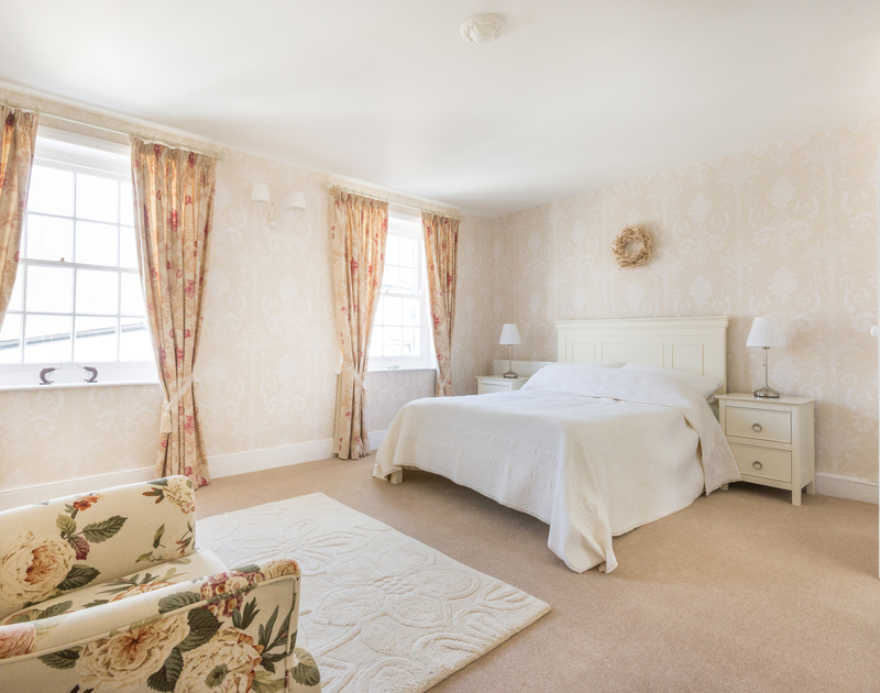Contemporary and stylish, this spacious master bedroom has a double bed and attractive furniture