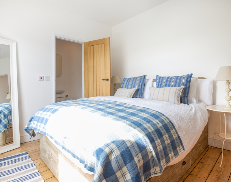 The master bedroom at Hagervor House, a newly refurbished and luxurious holiday rental a minute from the beach and sea at Polzeath in North Cornwall.