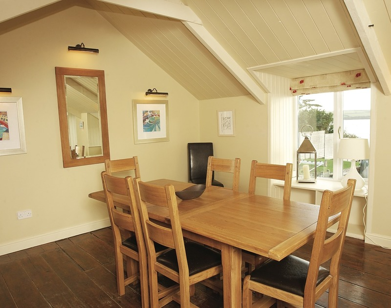 The dining room with pretty vaulted ceiling at The Cottage, a self catering, dog friendly, holiday rental on the Camel Estuary in Rock, North Cornwall.
