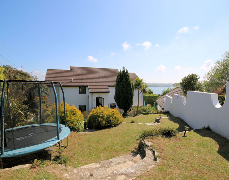 The main house and garden at Chy An Fos, a self catering holiday house on the Camel Estuary in Rock, North cornwall.