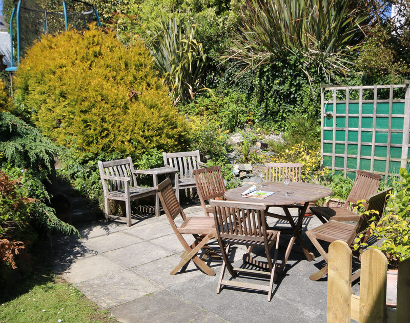 The sunny patio in Chy An Fos, a self catering, pet friendly holiday house to rent in Rock, North Cornwall.