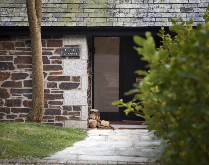 The entrance of The Old Granary, a self-catering holiday house in Rock, Cornwall, with sloping path to the front door.