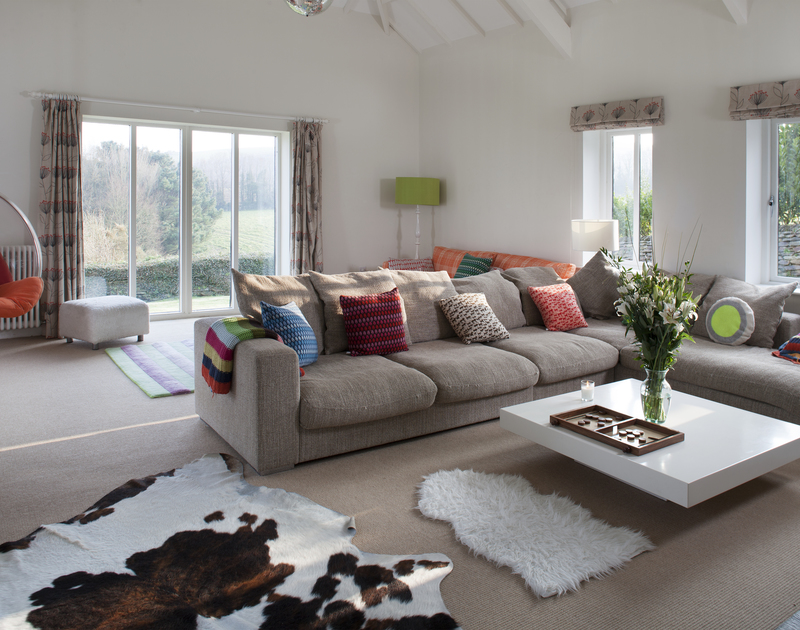 The stylish lounge of The Old Granary, a self-catering holiday house in Rock, Cornwall, with its colourful furnishings.