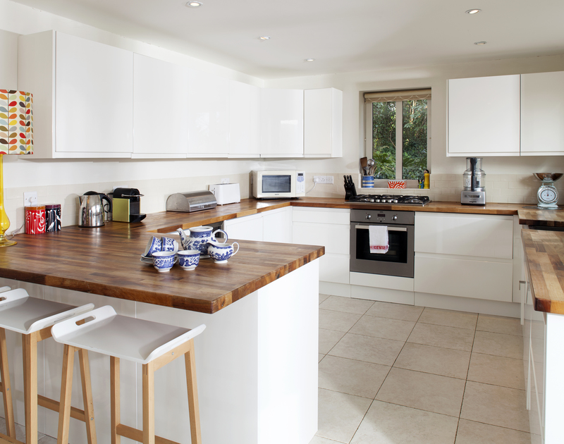 Stylish, modern kitchen of The Old Granary, a self-catering holiday house in Rock, Cornwall, with its breakfast bar.