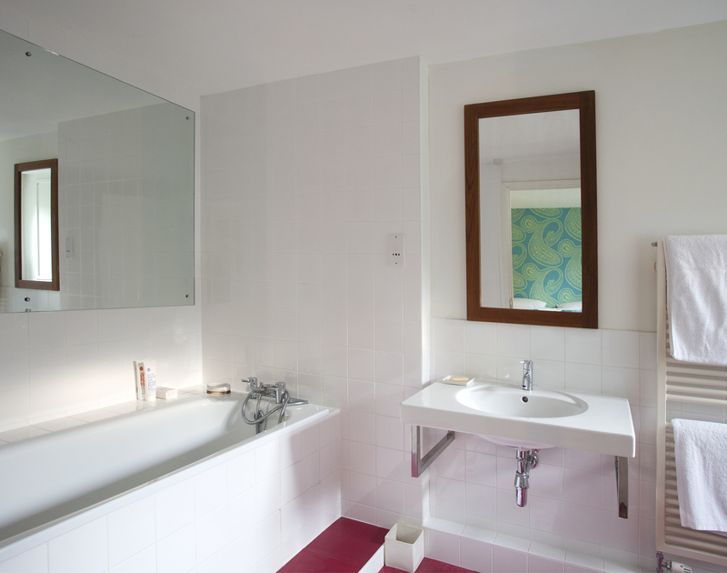 Spacious ground-floor ensuite bathroom at The Old Granary, a self-catering holiday house in Rock, Cornwall